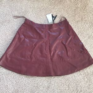 ANGL red oxblood vegan leather skirt.
